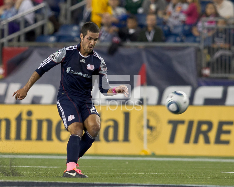 New England Revolution midfielder Benny Feilhaber (22) passes the ball. In a Major League Soccer (MLS) match, the San Jose Earthquakes defeated the New England Revolution, 2-1, at Gillette Stadium on October 8, 2011.