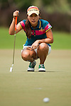 CHON BURI, THAILAND - FEBRUARY 16:  Hee Young Park of South Korea lines up a putt on the 16th hole during day one of the LPGA Thailand at Siam Country Club on February 16, 2012 in Chon Buri, Thailand.  Photo by Victor Fraile / The Power of Sport Images