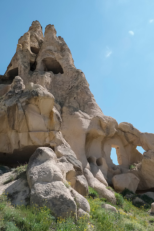 "Resembling swiss cheese, various rooms have been carved out of this ""fairy chimney"" rock formation in the Goreme Open Air Museum in Cappadocia region."