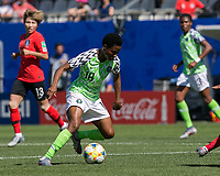 GRENOBLE, FRANCE - JUNE 12: Halimatu Ayinde #18 of the Nigerian National Team, second half substitute, controls the ball during a game between Korea Republic and Nigeria at Stade des Alpes on June 12, 2019 in Grenoble, France.