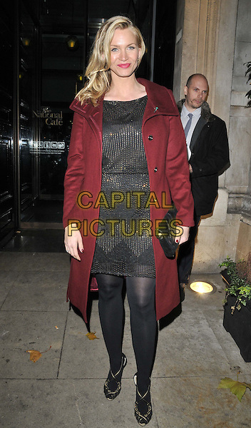 Natasha Henstridge.'Chicago' the musical press night afterparty, National Portrait Gallery Cafe, Charing Cross Road, London, England, UK, 10th November 2011..full length  red coat black sparkly dress tights clutch bag poppy burgundy  sandals .CAP/CAN.©Can Nguyen/Capital Pictures.