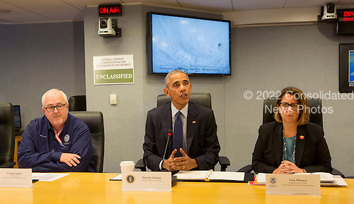 United States President Barack Obama makes a statement after receiving a briefing on Hurricane Matthew at the Federal Emergency Management Agency (FEMA) in Washington DC, October 5, 2016. Seated is FEMA Administrator Craig Fugate (left) and Lisa Monaco, U.S. Homeland Security Advisor to President Obama(right). <br /> Credit: Chris Kleponis / Pool via CNP