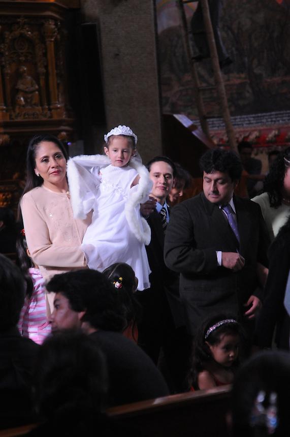Baptism of children in the Basilica de Nuestra Senora de Aqua Santa. Banos, Ecuador