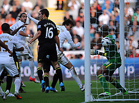 Saturday, 20 October 2012<br /> Pictured: Michu of Swansea (C of picture) scoring, goalkeeper Ali Al Habsi of Wigan (R) fails to stop the ball<br /> Re: Barclays Premier League, Swansea City FC v Wigan Athletic at the Liberty Stadium, south Wales.