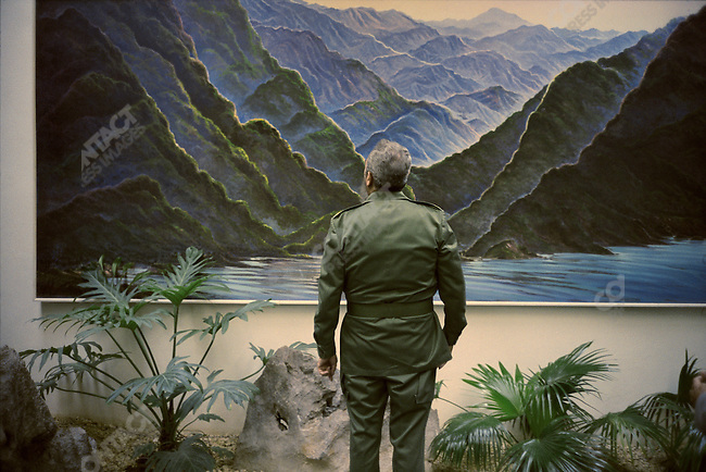 President Fidel Castro in front of a mural of the Sierra Maestra mountains where the Cuban revolution began. Presidential Palace, Havana, Cuba, Febuary 1995