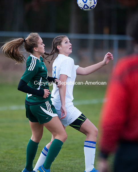 BURLINGTON,  CT-110716JS14- Lewis Mills' Alyssa Wrabel  (18) and Griswold's Zoe Lear (11) both got or the ball during their first round Class M tournament game Monday at Nassahegan Field in Burlington. . <br /> Jim Shannon Republican American