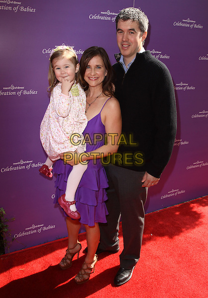 KELLIE MARTIN, DAUGHTER & KEITH CHRISTIAN.March of Dimes 4th Annual Celebration of Babies held At The Four Seasons Hotel, Beverly Hills, California, USA,.7th November 2009..full length purple dress married couple wife husband kid child family ruffles ruffle tiered .CAP/ADM/KB.©Kevan Brooks/AdMedia/Capital Pictures.