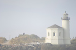 Coquille River Lighthouse at Bullards Beach State Park, Bandon, Oregon with visiting couple on a foggy day..#0510624