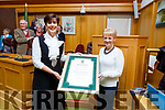 Cllr Norma Foley (Mayor of Kerry) presents a scroll to Julie Gleeson (Chairperson of the Listowel Tidy Towns Committe at the Kerry County Council civil reception to the Listowel Tidy Towns committee on Monday.
