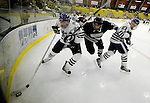 30 December 2007: Holy Cross Crusaders' defenseman Marty Dams (left 23), a Junior from Manotick, Ontario, battles Western Michigan University Broncos' Mike Lesperance at Gutterson Fieldhouse in Burlington, Vermont. The teams skated to a 1-1 tie, however the Broncos took the consolation game in a 2-0 shootout to win the third game of the Sheraton/TD Banknorth Catamount Cup Tournament...Mandatory Photo Credit: Ed Wolfstein Photo