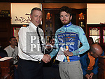 Superintendent Andrew Watters Chairperson of Drogheda Wheelers presents Andre Grennel of Arcane Cycling Club with the prize for best in A3 at the Peter Bidwell Memorial cycle at The Thatch Drogheda. Photo:Colin Bell/pressphotos.ie