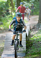 NWA Democrat-Gazette/JASON IVESTER<br /> Walker Clark, 12, rides along the Slaughter Pen Trail in Bentonville on Thursday, June 23, 2016, with others as part of The New School's Mountain Bike Camp. Led by Jason Mitchell and Dasun (cq) Keylor (cq), boys and girls between fifth and eighth grades are participating in the week-long camp which is part of the Fayetteville school's summer program.