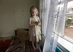 Iana, 4 years old in her home in Maksimovichy village.In remote villages with limited access to hospitals and doctors, radiation controls are no longer available. There families have seen their situation aggravated by the latest conflicts in Ukraine