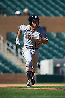 Glendale Desert Dogs shortstop Adam Frazier (12) runs to first during an Arizona Fall League game against the Surprise Saguaros on October 23, 2015 at Salt River Fields at Talking Stick in Scottsdale, Arizona.  Glendale defeated Surprise 9-6.  (Mike Janes/Four Seam Images)