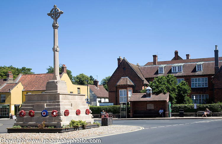 War memorial and historic buildings in the town of Holt, north Norfolk, England