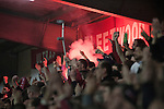 Fleetwood Town 1 Wrexham 1, 10/04/2012. Highbury Stadium, Football Conference Premier. Home fans in the Memorial Stand lighting a flare as they celebrate their team's equalising goal as Fleetwood Town (in red) host Wrexham in a Blue Square Conference Premier match at Highbury Stadium. The match, between the top two teams in the division ended in a 1-1 draw watched by a near-capacity crowd of 4996. A victory for the hosts would have seen the club promoted to the Football League for the first time. Photo by Colin McPherson.