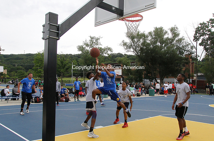 WATERBURY, CT - 29 JULY 2017 - 072917JW14.jpg -- Teams compete during the Hoop to Help basketball Tournament Saturday afternoon at the Waterbury Police Athletic League. Funds raised from the event hosted by the Community Tabernacle Outreach Center, will go to buying book bags and school supplies to anyone who needs them to be distributed Aug. 20th at the Community Tabernacle Outreach Center.  Jonathan Wilcox Republican-American