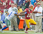 Washington Redskins wide receiver Josh Doctson (18) runs away from Dallas Cowboys free safety Byron Jones (31) in fourth quarter action at FedEx Field in Landover, Maryland on Sunday, September 18, 2016.  The Cowboys won the game 27 - 23.<br /> Credit: Ron Sachs / CNP
