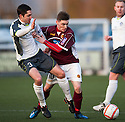 Stranraer's David MacGregor and Stenny's Sean Dickson challenge for the ball.