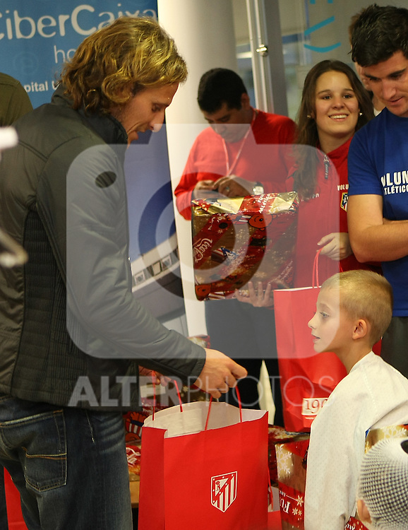 "Atletico de Madrid's player Diego Forlan  during a visit to the Children's Hospital ""La Paz"" in Madrid. January 04 2010..(ALTERPHOTOS/Acero)."