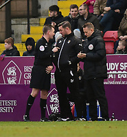 Referee Ross Joyce speaks to Notts County manager Kevin Nolan<br /> <br /> Photographer Chris Vaughan/CameraSport<br /> <br /> The EFL Sky Bet League Two - Lincoln City v Notts County - Saturday 13th January 2018 - Sincil Bank - Lincoln<br /> <br /> World Copyright &copy; 2018 CameraSport. All rights reserved. 43 Linden Ave. Countesthorpe. Leicester. England. LE8 5PG - Tel: +44 (0) 116 277 4147 - admin@camerasport.com - www.camerasport.com