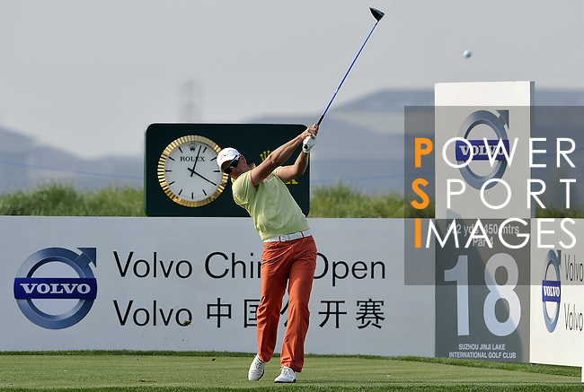 SUZHOU, CHINA - APRIL 16:  Henrik Stenson of Sweden tees off on the 18th hole during the Round Two of the Volvo China Open on April 16, 2010 in Suzhou, China. Photo by Victor Fraile / The Power of Sport Images