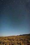 Night sky with stars, Ursa Major over the Bodie Hills of California, moon lit landscape