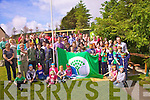 Pupils, staff, parents and neighbours of Coars N.S. came out on Friday to listen to Brian Sheehan talk about healthy eating, 'Exercise and healthy  lifestyle will keep us happy, active and alert', he said.  The exotic fruit was sponsored by Dermot Walsh of Super Valu.  The school was also awarded a Green Flag which was raised on the day by Brian Sheehan, a time capsule was also buried containing some works by the pupils.  The summer sunshine helped make the day with a real party atmosphere.