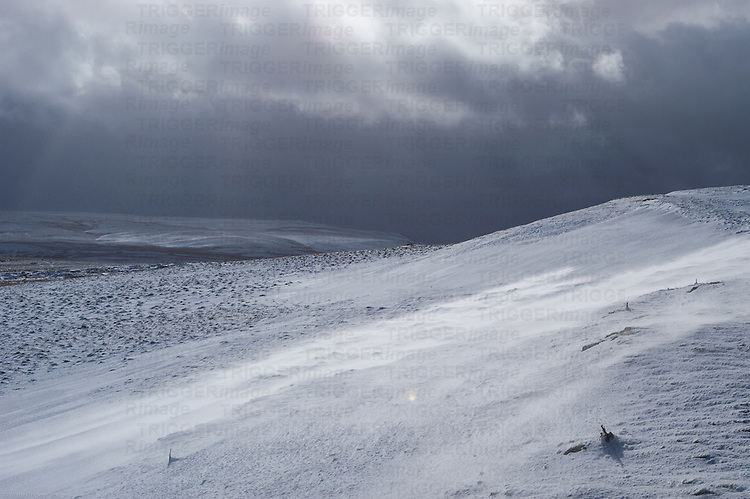 View across open moorland during heavy snowfall. Close to Ullswater in the Eastern Lake District. Cumbria, UK