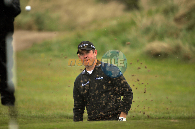 Lee Westwood chips out of a bunker onto the 15th green during Round1 of the 3 Irish Open on 16th May 2009 (Photo by Eoin Clarke/GOLFFILE)