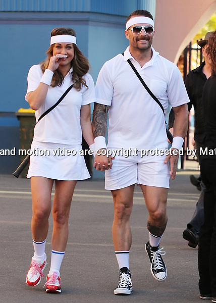 27 NOVEMBER  2013 SYDNEY AUSTRALIA<br /> <br /> EXCLUSIVE PICTURES<br /> <br /> Michelle Bridges pictured with Commando Steve in matching tennis themed costumes at Luna Park for the Movember Gala. <br /> <br /> *No internet without clearance*.<br /> MUST CALL PRIOR TO USE <br /> +61 2 9211-1088. <br /> <br /> Matrix Media Group.Note: All editorial images subject to the following: For editorial use only. Additional clearance required for commercial, wireless, internet or promotional use.Images may not be altered or modified. Matrix Media Group makes no representations or warranties regarding names, trademarks or logos appearing in the images.