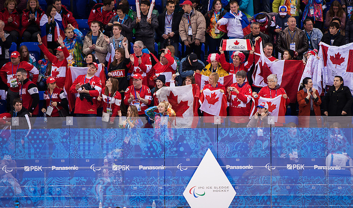 Sochi, RUSSIA - Mar 11 2014 -  Canadian fans celebrate a goal as Canada takes on Czech Republic in Sledge Hockey at the 2014 Paralympic Winter Games in Sochi, Russia.  (Photo: Matthew Murnaghan/Canadian Paralympic Committee)