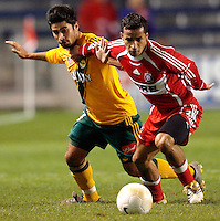 Chicago Fire midfielder Ivan Guerrero (23) tries to hold off LA Galaxy midfielder Paulo Nagamura (17).  The Chicago Fire defeated the Los Angeles Galaxy 3-1 in the championship game of the U.S. Open Cup at Toyota Park in Bridgeview, IL on September 27, 2006...
