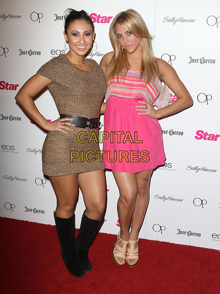 """Francia Raisa, Cassie Scerbo.Star Magazine's """"All Hollywood"""" Event With Performance By Karmin Held at AV Nightclub, Hollywood, California, USA..April 24th, 2012.full length black belt brown knitted dress  boots pink striped stripes hand on hip .CAP/ADM/KB.©Kevan Brooks/AdMedia/Capital Pictures."""