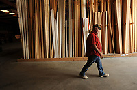 NWA Democrat-Gazette/ANDY SHUPE<br /> Lloyd Center, yard foremen at City Lumber in Fayetteville, walks through a storage facility Friday, May 26, 2017, at the longtime business in south Fayetteville. Center has worked at lumber yards since the mid-1970s.