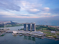 Singapore. Marina Bay Sands Hotel and Central Business District seen from Altitude restaurant and bar at the 61st and 62nd floor of One Raffles Place.
