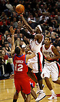 12/26/11--Trail Blazers forward Gerald Wallace drives 76ers' Evan Turner in the fourth quarter..Photo by Jaime Valdez. .......................................
