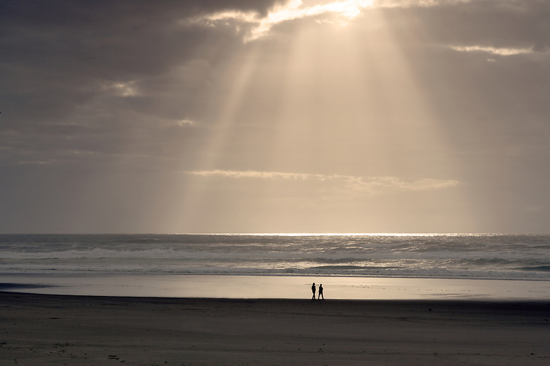 People walking on beach. Rockaway Beach. Oregon