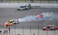 Nov. 8, 2009; Fort Worth, TX, USA; NASCAR Sprint Cup Series drivers Carl Edwards (99), Jeff Gordon (24) and Juan Pablo Montoya (42) crash during the Dickies 500 at the Texas Motor Speedway. Mandatory Credit: Mark J. Rebilas-
