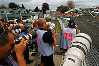 Photographers shoot the start of the feature race on the final day during Day Three of the Hamilton 400 Aussie V8 Supercars Round Two at Frankton, Hamilton, New Zealand on Sunday, 19 April 2009. Photo: Dave Lintott / lintottphoto.co.nz