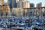 Vancouver marina area showing apartment, office blocks marina and Granville bridge at dusk. British Columbia, Canada