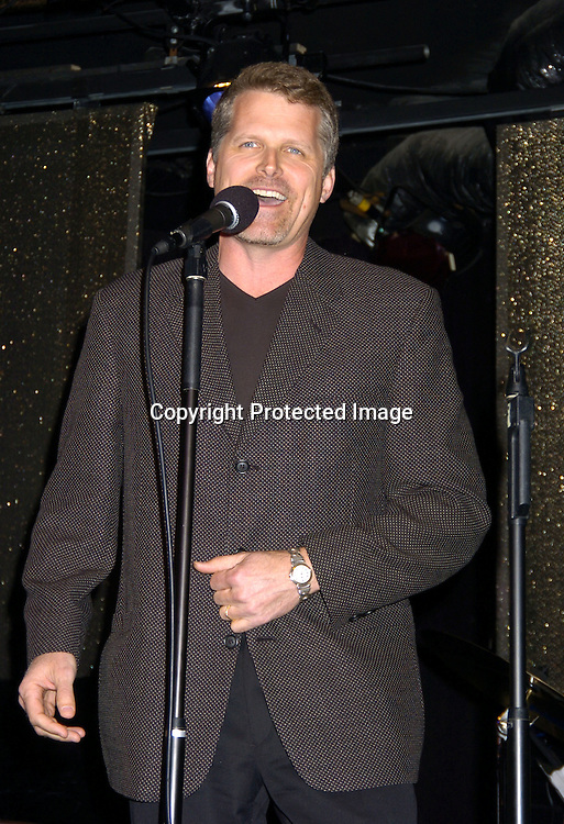 Robert Newman  singing..at The Goldin and Park Cabaret starring Ricky Paull Goldin from Guiding Light and Michael Park from As The World Turns. Kim Zimmer, Robert Newman and Mandy Bruno also sang. This was at The Triad NYC on April 16, 2005, and  was a benefit for Bill Runyon's family. ..Photo by Robin Platzer, Twin Images