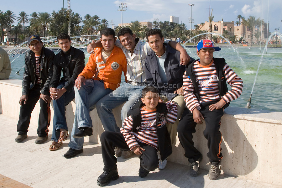 Tripoli, Libya - Young Libyan Men, in Western Clothes.  National Museum, Sarraya al-Hamra, in Background.