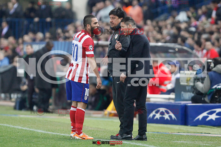 Atletico de Madrid´s Arda Turan (L), coach Diego Simeone and second coach German Burgos during 16th Champions League soccer match at Vicente Calderon stadium in Madrid, Spain. March 11, 2014. (ALTERPHOTOS/Victor Blanco)