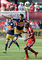 20 July 2013: New York Red Bulls forward Fabian Espindola #9 and Toronto FC defender Ashtone Morgan #5 in action during an MLS regular season game between the New York Red Bulls and Toronto FC at BMO Field in Toronto, Ontario Canada.