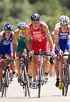 02 JUN 2013 - MADRID, ESP - Javier Gomez (ESP) (#1, second from the right in red) of Spain leads the front pack during the bike at the men's ITU 2013 World Triathlon Series round in Casa de Campo, Madrid, Spain (PHOTO (C) 2013 NIGEL FARROW)