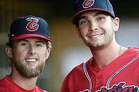 Cole Brannen and Triston Casas of the Greenville Drive, playing as the Energia in MiLB's Copa de la Diversion, pose for a photo in the dugout before a game against the Augusta GreenJackets on Wednesday, April 10, 2019, at Fluor Field at the West End in Greenville, South Carolina. Augusta won, 9-8. (Tom Priddy/Four Seam Images)