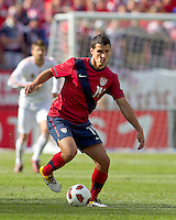 USA defender   Eric Lichaj (14) dribbles at midfield. In a friendly match, Spain defeated USA, 4-0, at Gillette Stadium on June 4, 2011.