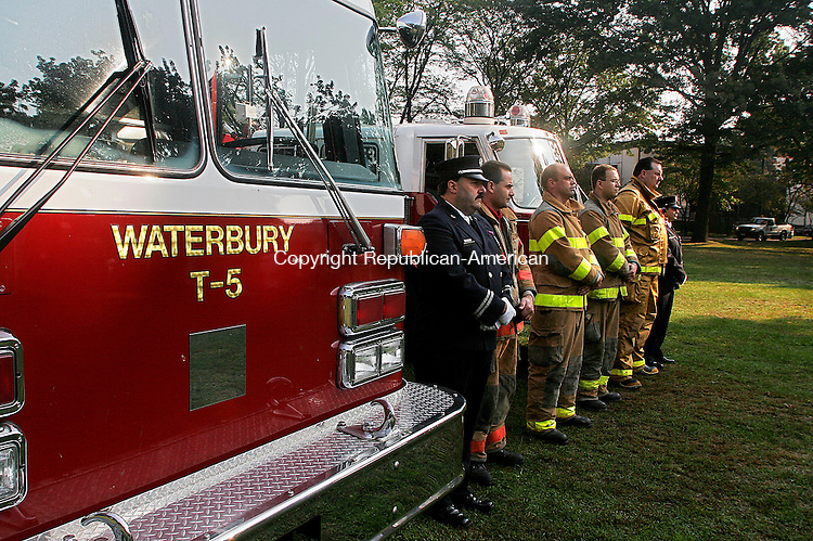 WATERBURY, CT - 09 SEPTEMBER 2006 - 090906JW01.jpg -- Waterbury and Middlebury fire officials stand at attention during a 9/11 Memorial ceremony at Library Park Saturday morning.   Jonathan Wilcox Republican-American