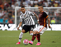 Calcio, Serie A: Roma vs Juventus. Roma, stadio Olimpico, 30 agosto 2015.<br /> Roma&rsquo;s Radja Nainggolan, right, is challenged by Juventus&rsquo; Roberto Pereyra during the Italian Serie A football match between Roma and Juventus at Rome's Olympic stadium, 30 August 2015.<br /> UPDATE IMAGES PRESS/Isabella Bonotto